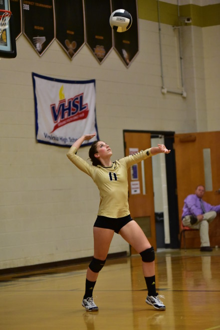 #11 Kayley Widelo serving