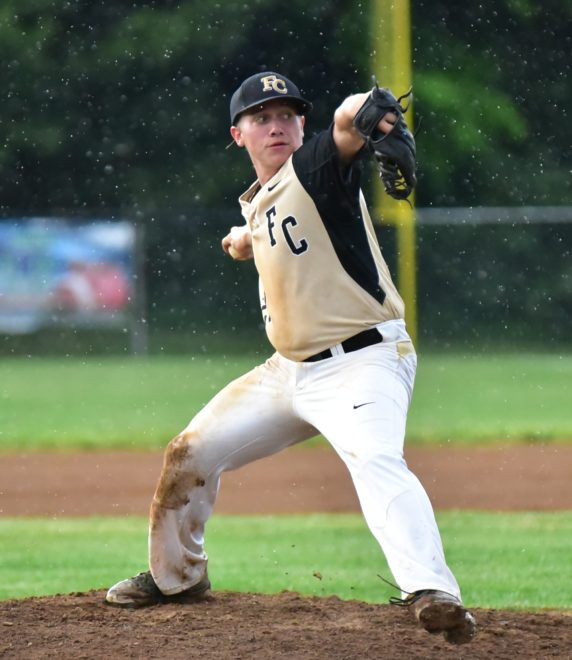 Second pitcher of the night, Bryson Booher pitching in the rain.